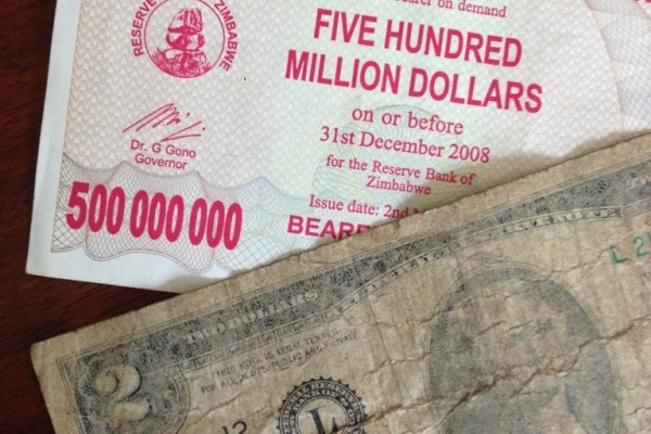 Just a few years ago when Zimbabwe's economy was at its lowest, $500,000,000 might be able to buy you a loaf of bread. Now, Zimbabwe has officially changed to the US Dollar, and the old notes are simply worth their value in paper. Today, we're using US bills, and many of them are holding together by a thread.