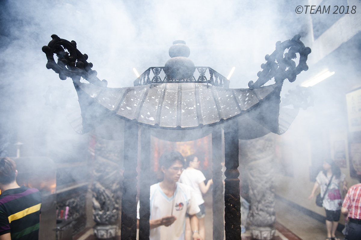 Man in cloud of incense