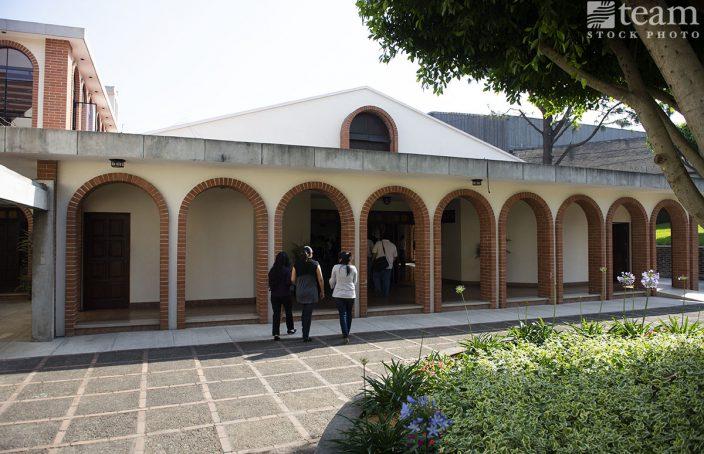 Three women in Mexico enter a building