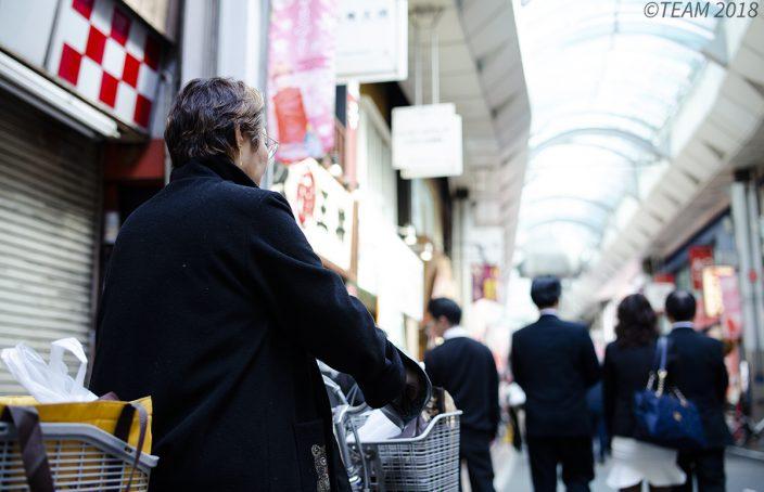 A woman in her golden years runs errands