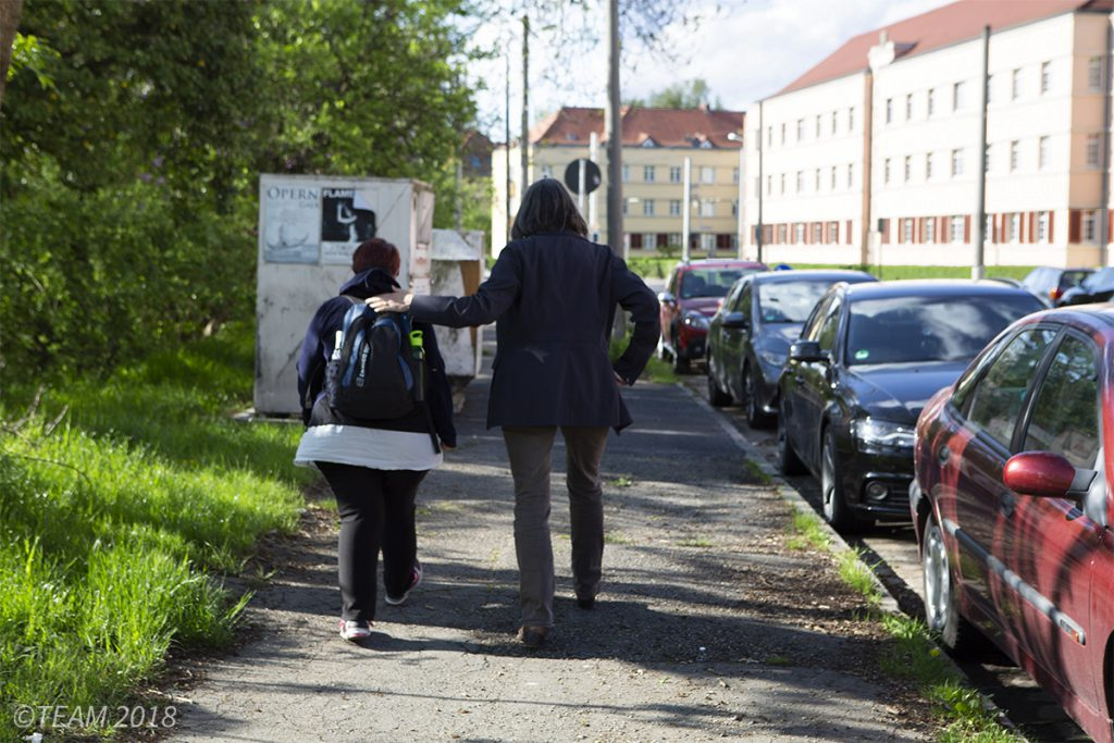 A missionary in Germany walks along the street with a local woman
