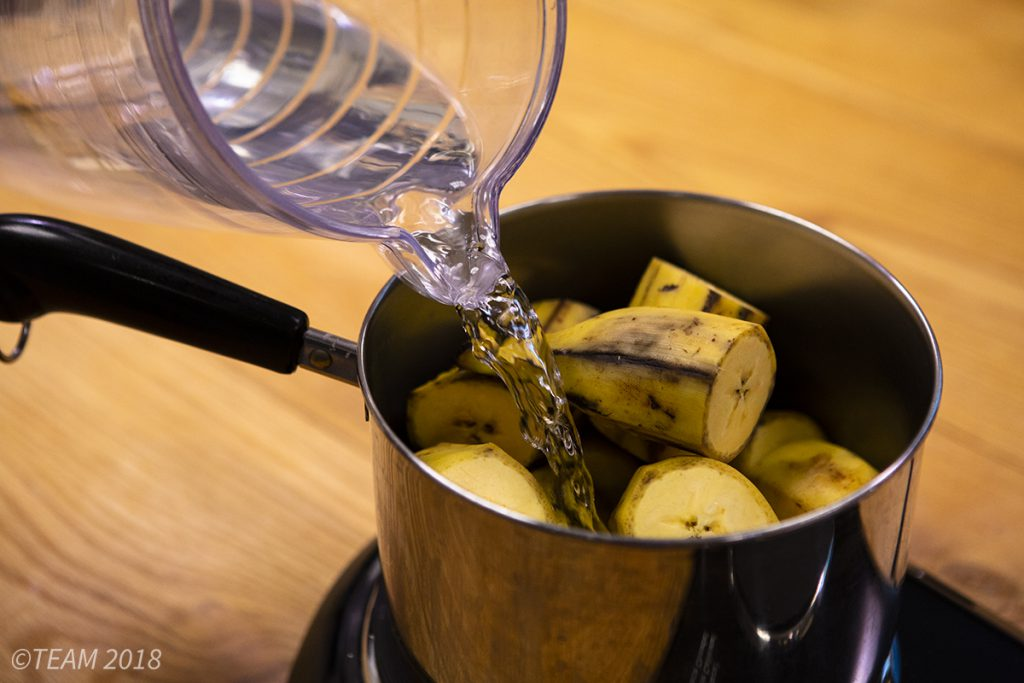 Add water to the chopped plantains