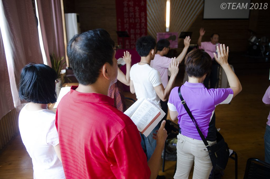 People worshiping in a church plant