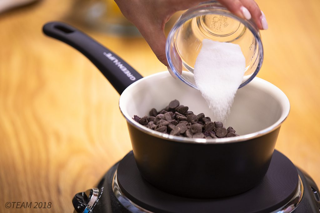 Add sugar and chocolate to the black beans.