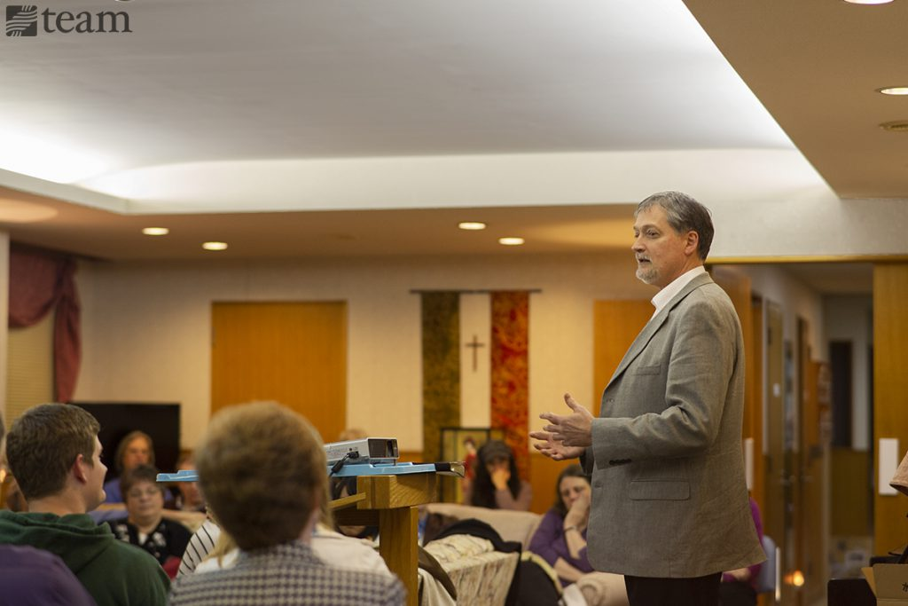 A missionary speaks at a conference.