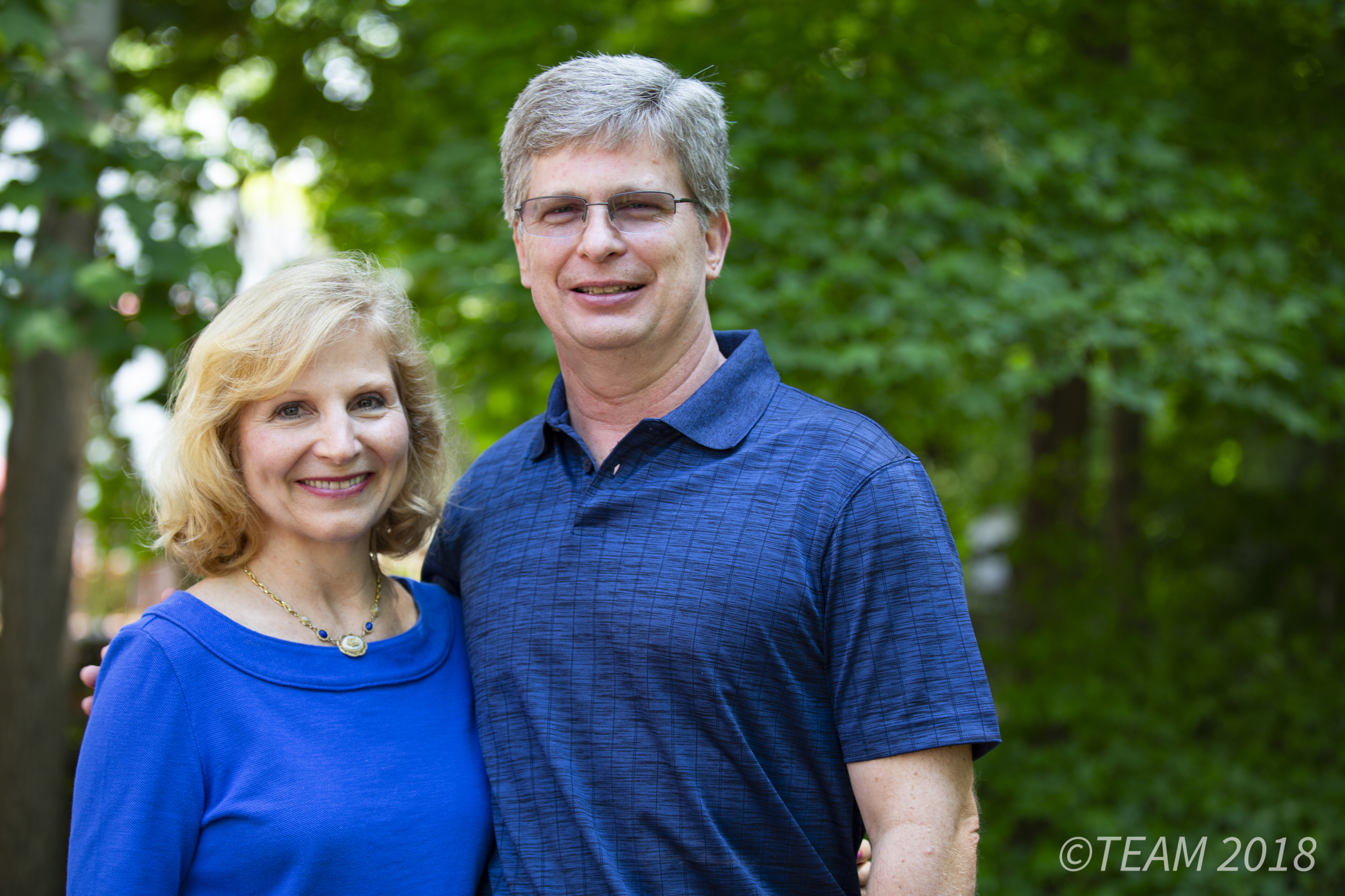 Missionaries Keith and Dawn Moore pose outside of their home in Charlotte, NC.
