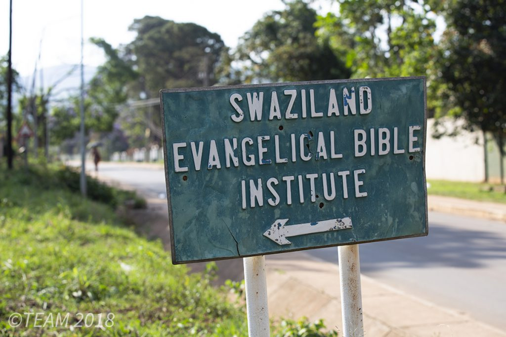 A sign points out the direction to Swaziland Evangelical Bible College