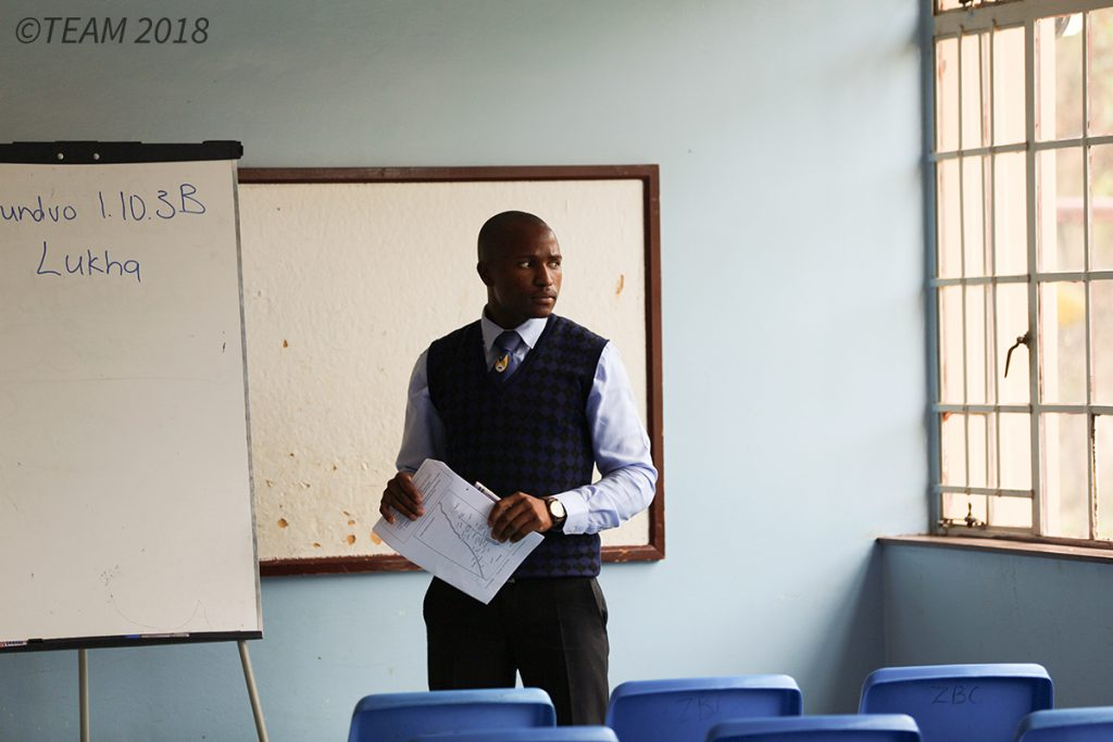 A professor at a Bible college prepares for class.