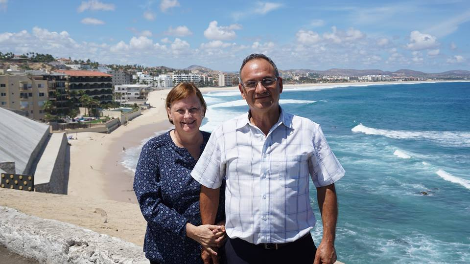 Vicki and Art Reyes on a Mexican beach, where they serve as TEAM missionaries