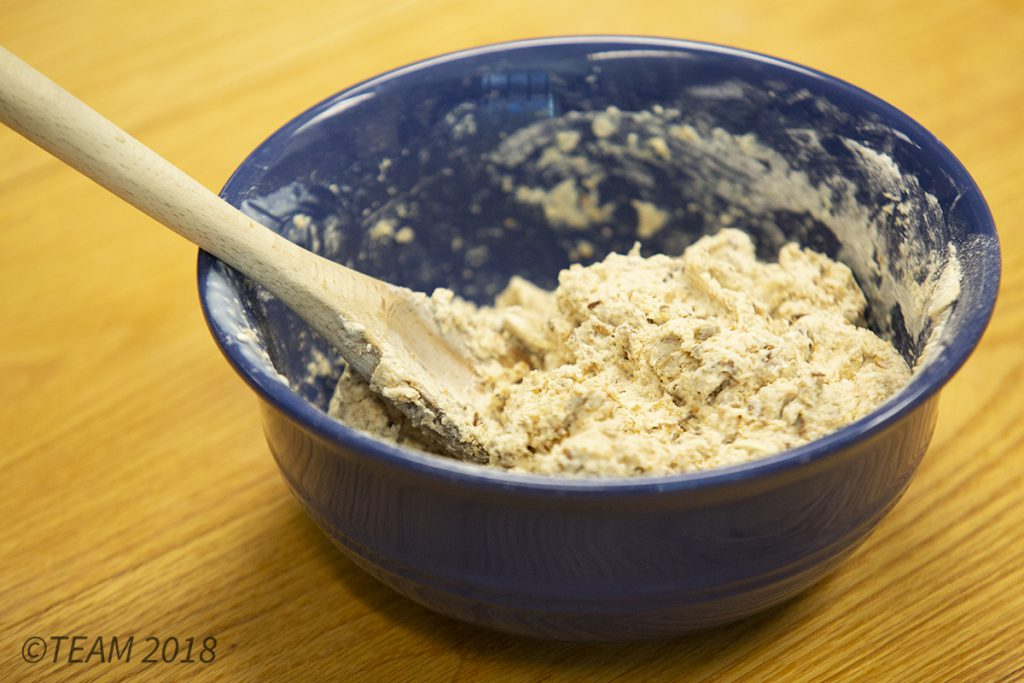 The Irish soda bread dough mixture should be thick once all of the ingredients are mixed together.