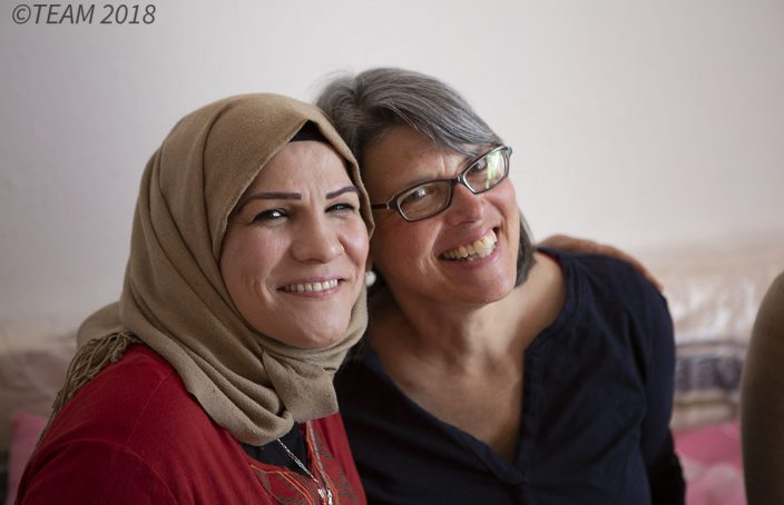 Anne Ingram smiles with one of her refugee friends