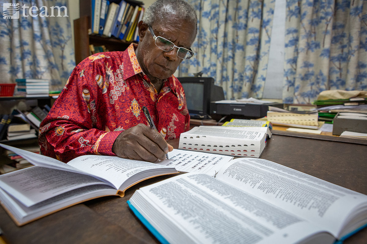 A man works on translating the Bible