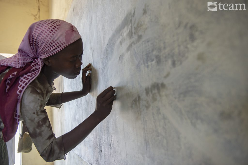 A woman in Chad is learning to write.