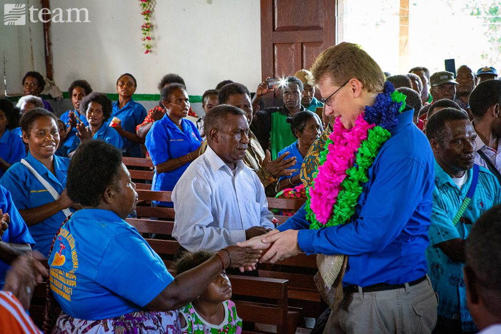 A TEAM missionary works with people in a church in Papua, Indonesia
