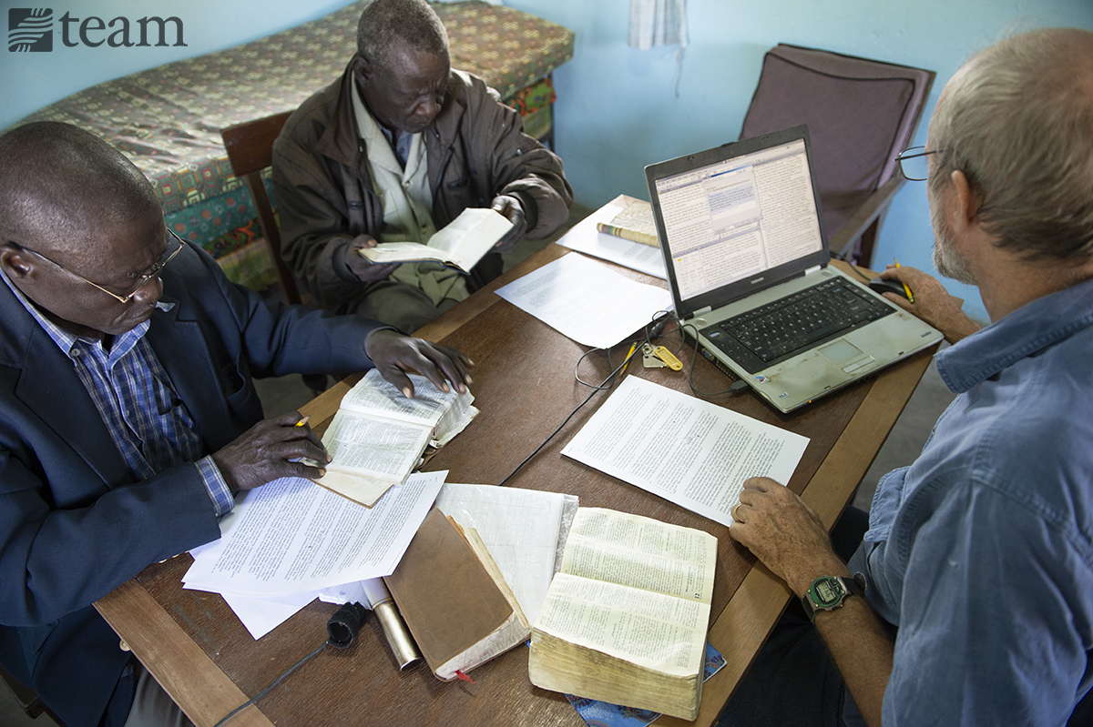 A group of men in Chad work on a Bible translation project