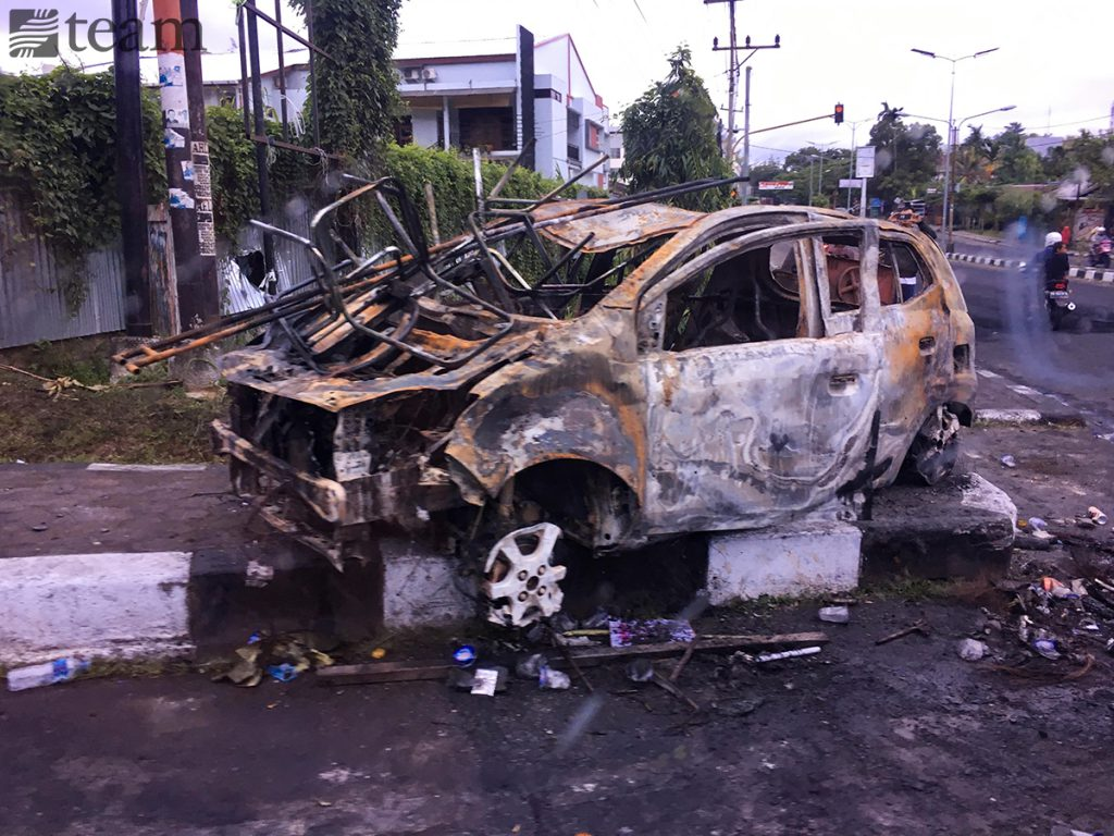A car that was set on fire during the protests in Papua in August 2019