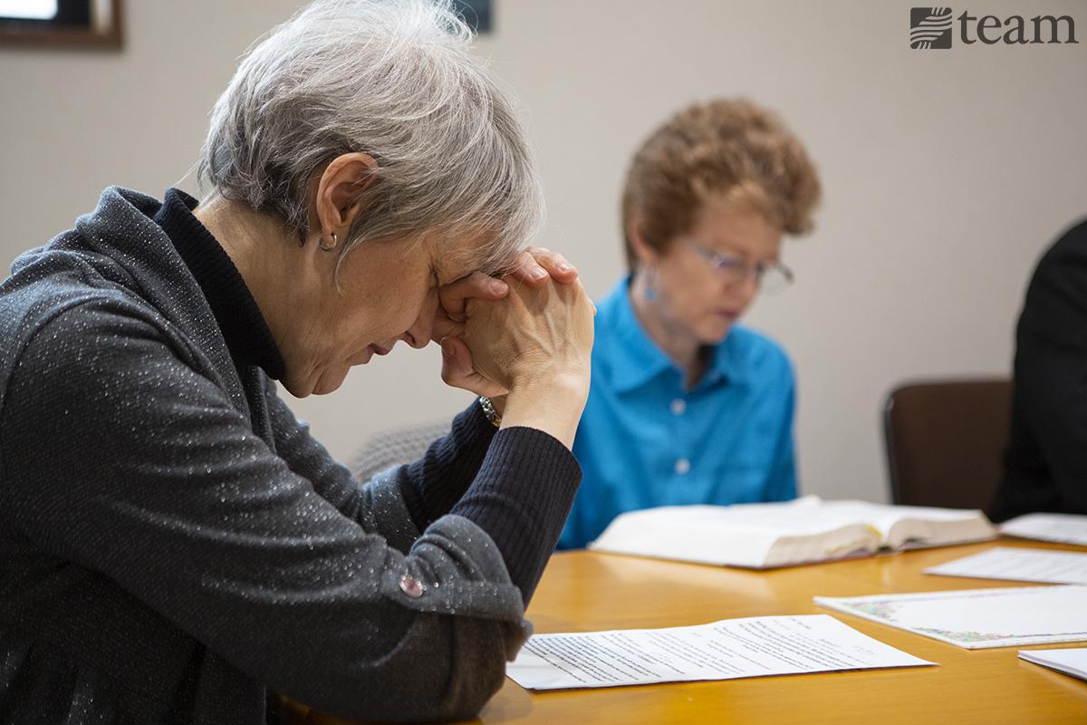Women praying together