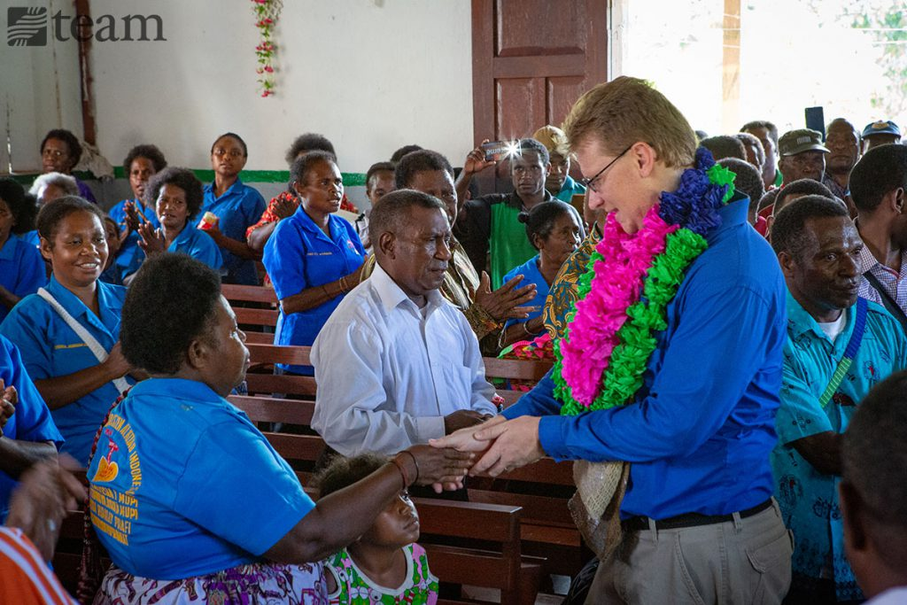 A missionary works with and interacts with locals.