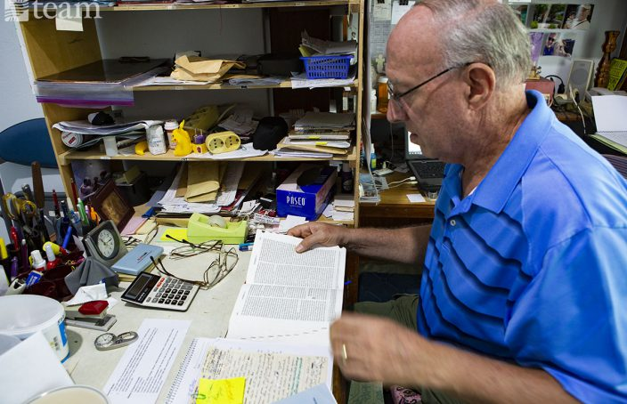 TEAM missionary Walter Kennedy reads the Bible at his desk. During COVID-19, he does missionary work online.