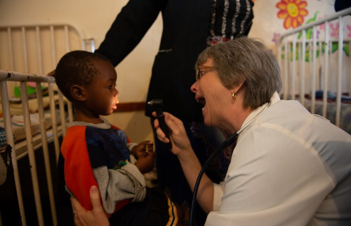 TEAM missionary doctor at Karanda Mission Hopsital asks to see inside a child's mouth
