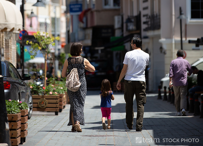 Urban ministry can be exhausting. A family in this photo takes a stroll together.