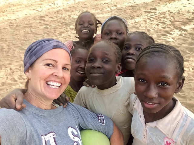 Annie takes a selfie with six Chadian girls after a sports game