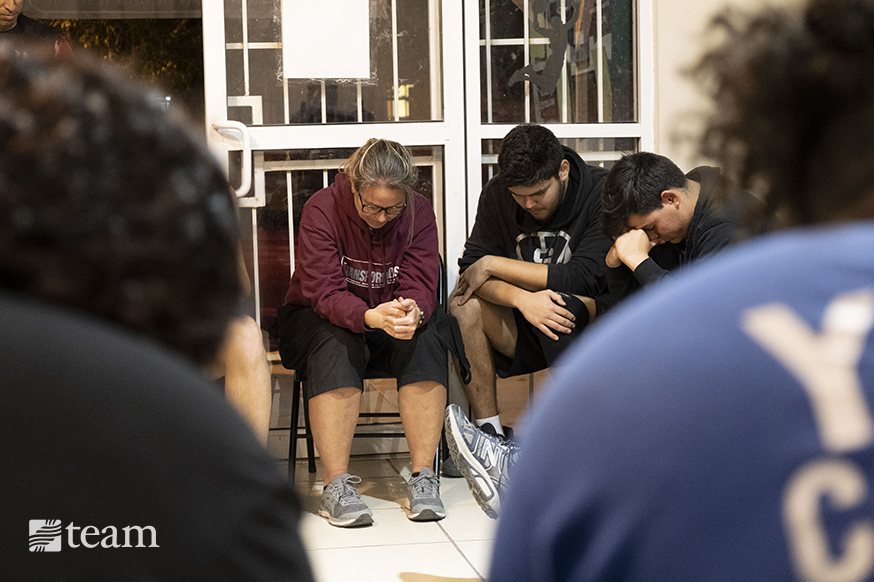 After practice, the teens gather for a time of Bible discussion and prayer, allowing them to draw near to God and ask questions.