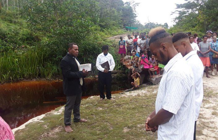 Papuan pastor Nimbrot preaches at a baptismal service