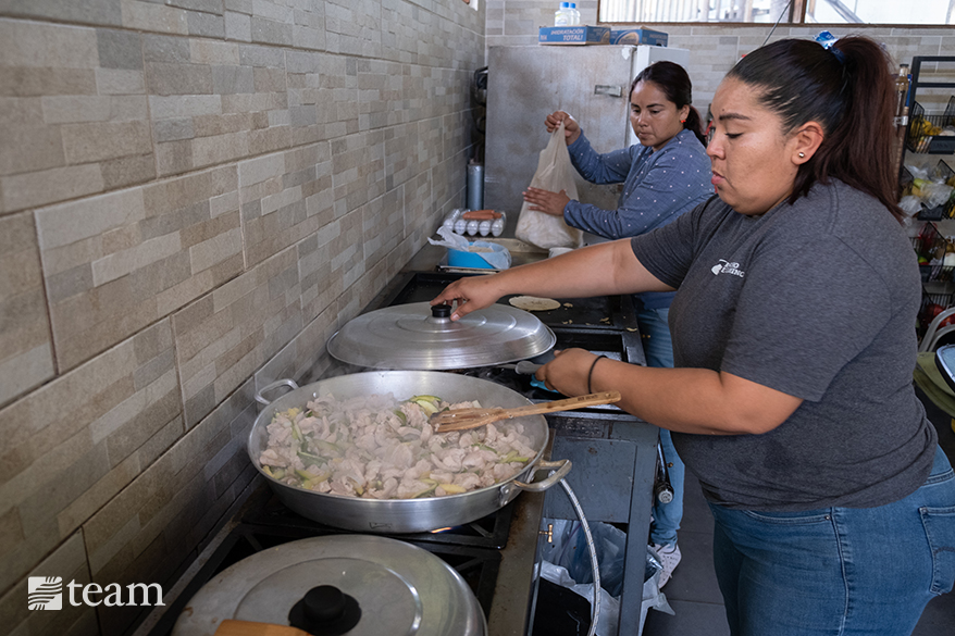 While serving at the food kitchen, Gaby became curious about God. After the kitchen closed, Gaby started volunteering to cook at Rancho el Camino events.