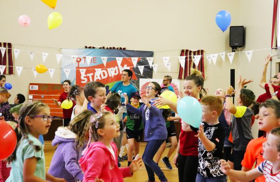 Kids playing with balloons at Salt Factory Sports Ministry Event